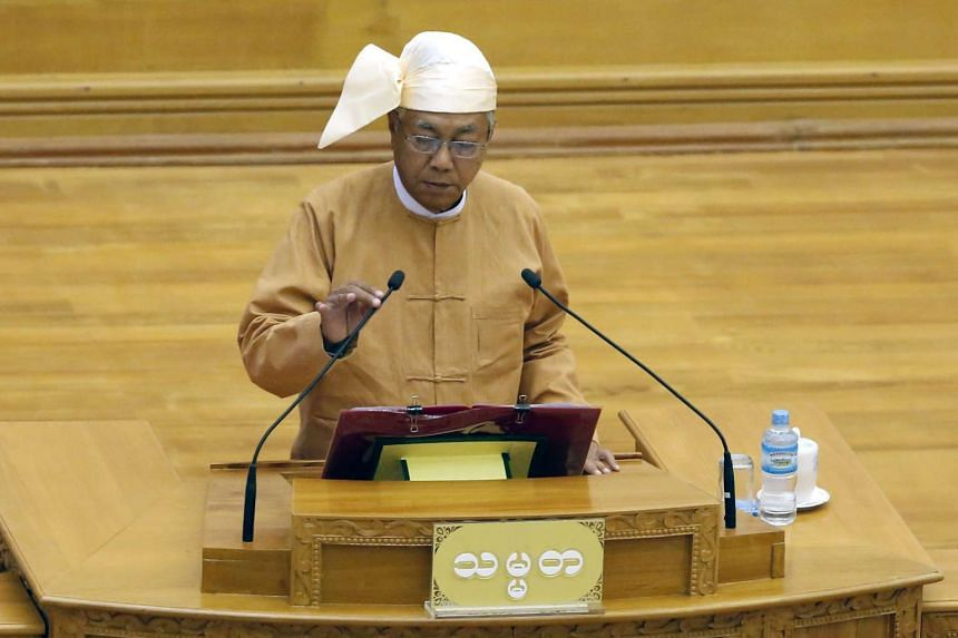New Myanmar president Htin Kyaw speaks at the Union Parliament as he takes oath during a swearing in ceremony in Naypyitaw, Myanmar.