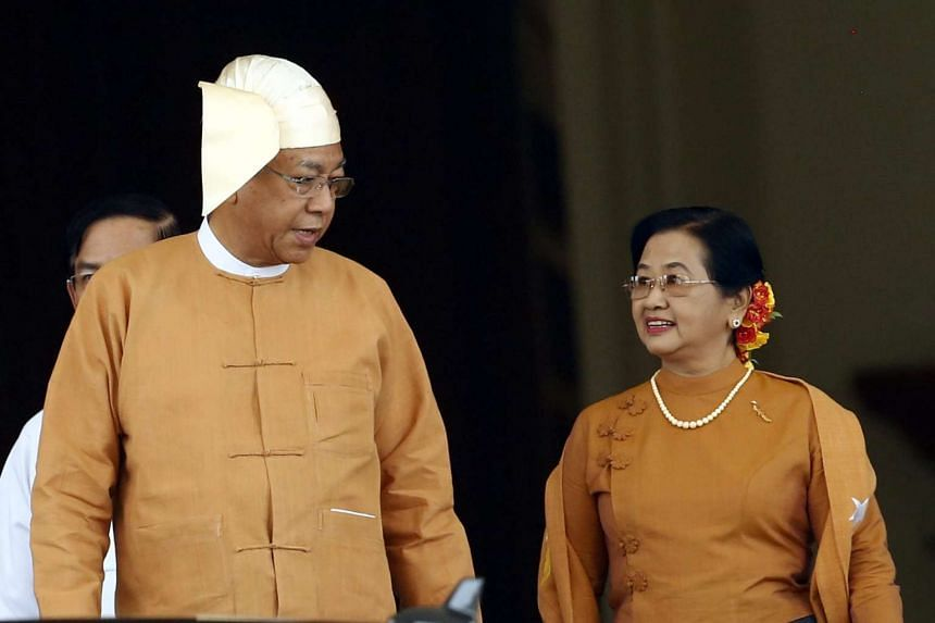 New Myanmar president Htin Kyaw (left) and his wife Su Su Lwin (right) leave the Union Parliament after taking oath in a swearing in ceremony in Naypyitaw, Myanmar.