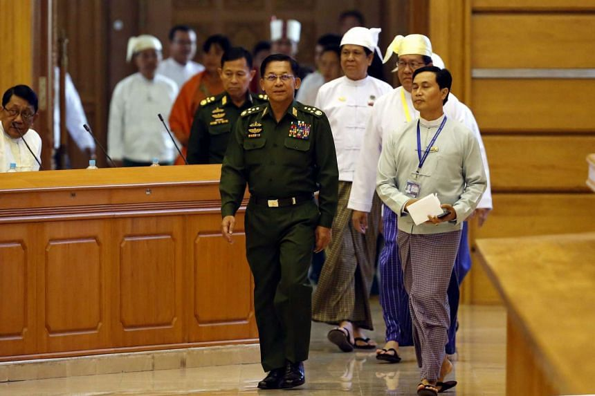 Senior General Min Aung Hlaing (centre) arrives at the Union Parliament in Naypyitaw, Myanmar.