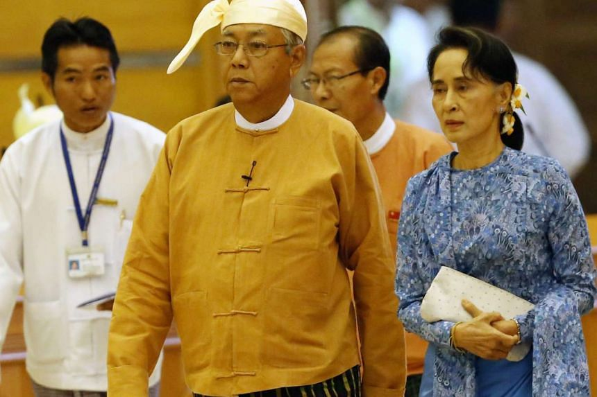 Myanmar's new president Htin Kyaw (left) and Myanmar democracy leader Aung San Suu Kyi (right) arrive at the Union Parliament to take oath in Naypyitaw, Myanmar.