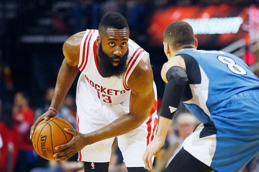 Rockets guard James Harden (left) playing against the Minnesota Timberwolves on March 18.