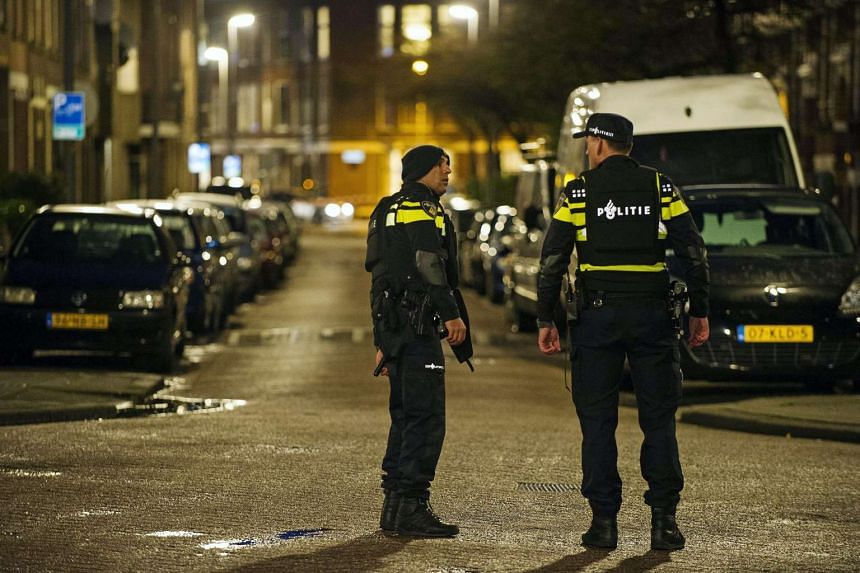 Police stand guard in Rotterdam-West, The Netherlands, on March 27, 2016.