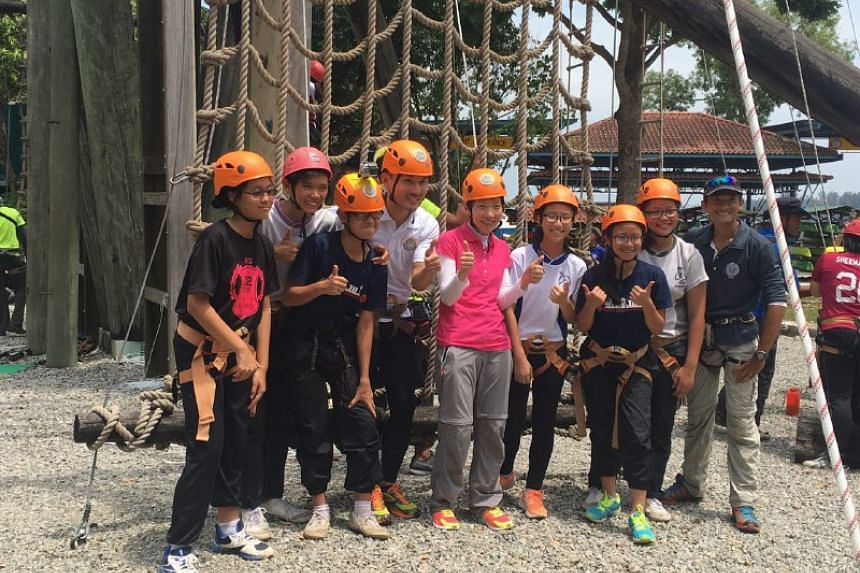 Minister Grace Fu (centre) and MCCY Parliamentary Secretary Baey Yam Keng (fourth from left) with OBS participants at OBS Ubin.