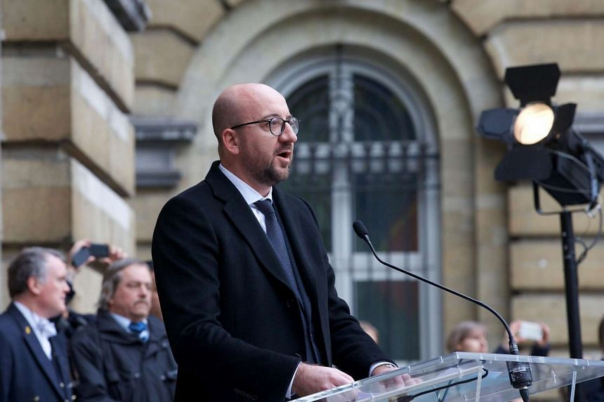 Belgian Prime Minister Charles Michel delivers a speech to commemorate the victims of March 22 terrorist attacks in Brussels on March 24, 2016.