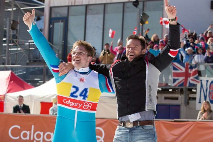 """Taron Egerton (far left) as unlikely ski jumping Olympian Michael """"Eddie"""" Edwards has you rooting for him despite his lack of talent, and Hugh Jackman plays his straight-talking coach."""