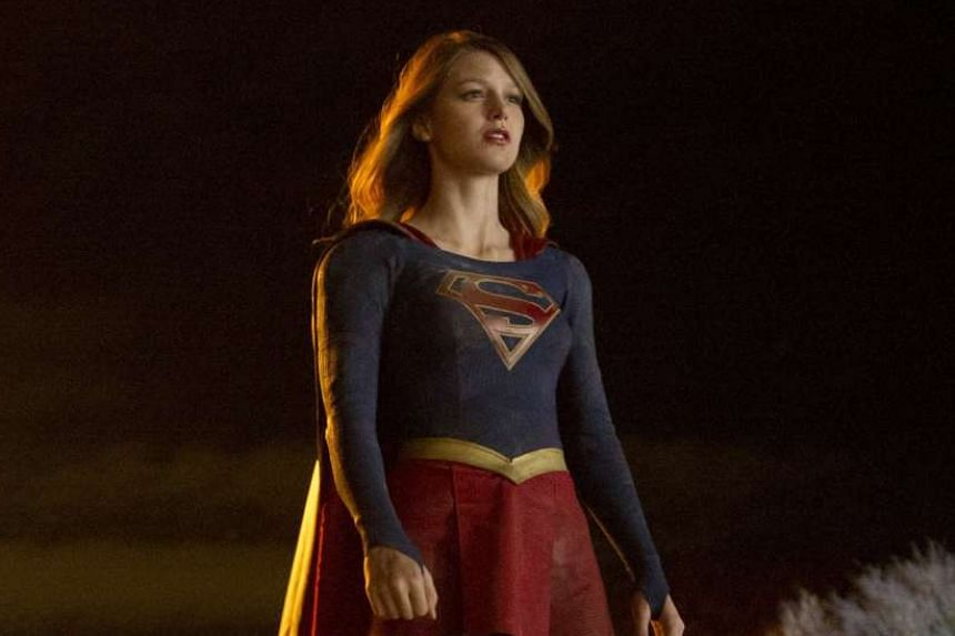 Supergirl (Melissa Benoist, above) and The Flash (Grant Gustin) meet on screen as part of careful world-building by their creators.