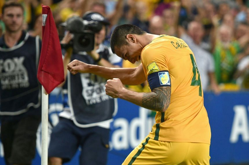 (Above) Tim Cahill of Australia celebrates his second goal against Jordan at the Sydney Football Stadium.