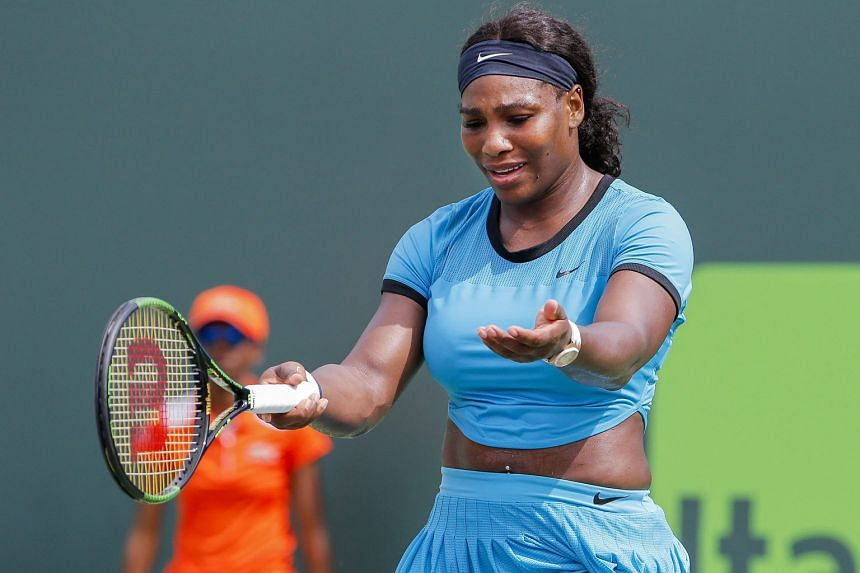 Serena Williams shows her frustration during her 6-7 (3-7), 6-1, 6-2 defeat at the hands of Svetlana Kuznetsova in the fourth round of the Miami Open, a tournament she has won the last three years.