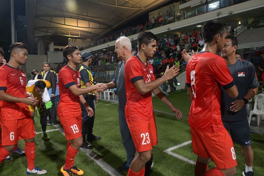Bernd Stange (middle) with his players after the 2-1 victory against Myanmar in his last home game last week. After the 1-2 loss to Afghanistan in Teheran last night, Stange advocated higher levels of fitness.