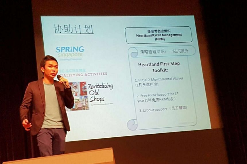 NTU Nanyang Business School final year student Royston Chua sharing his project group's suggestions on how to revitalise heartland businesses at the Singapore Heartland Enterprise Seminar on March 30, 2016.