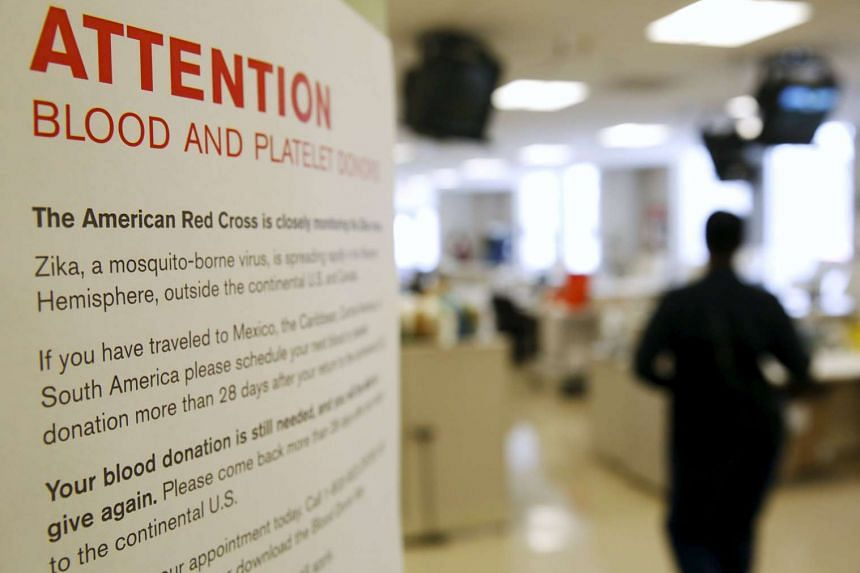 A sign explaining the parameters concerning the Zika virus and blood donations is seen at the American Red Cross Charles Drew Donation Center in Washington on Feb 16, 2016.