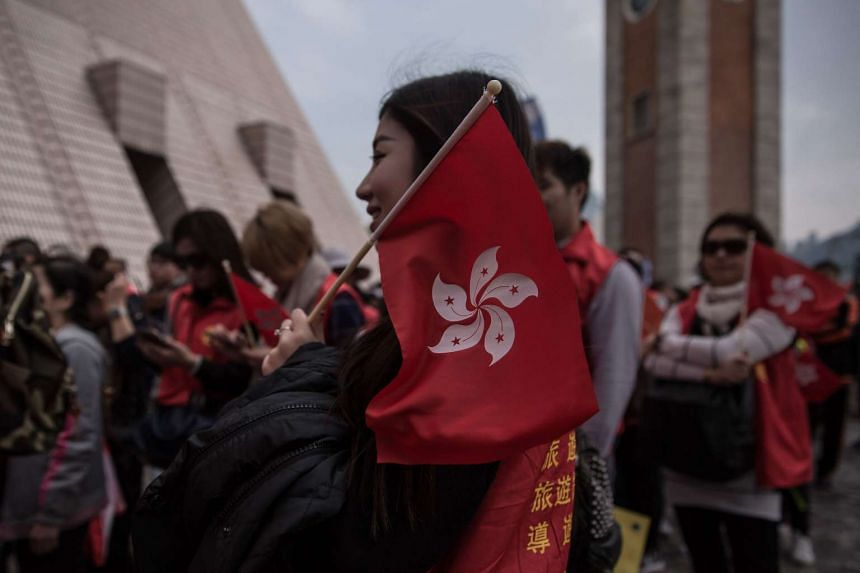 A woman holds a Hong Kong flag following Feb 9 clashes between protesters and police in the Mongkok district of Hong Kong.