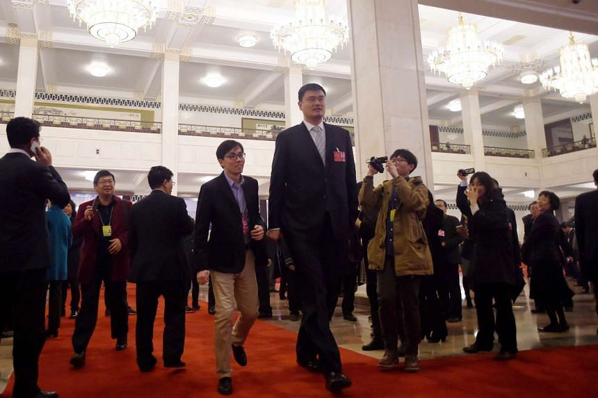 Former Chinese NBA star Yao Ming (centre) attends the opening session of the Chinese People's Political Consultative Conference at the Great Hall of the People in Beijing.