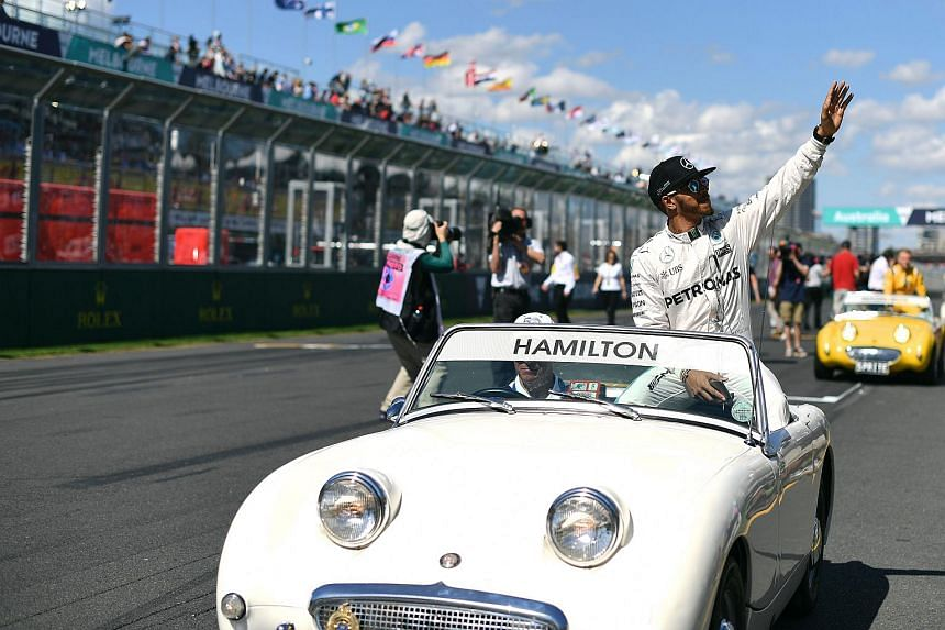 Lewis Hamilton gestures to the crowd during the drivers parade before the start of the Formula One Australian Grand Prix in Melbourne.