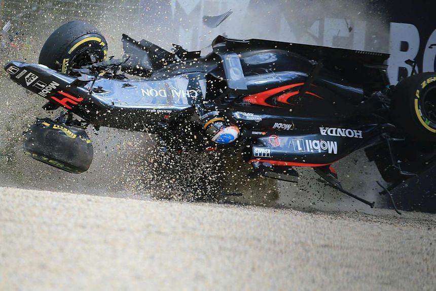 McLaren's Fernando Alonso crashes into the wall after colliding with Esteban Gutierrez during the Australian Grand Prix, on March 20.