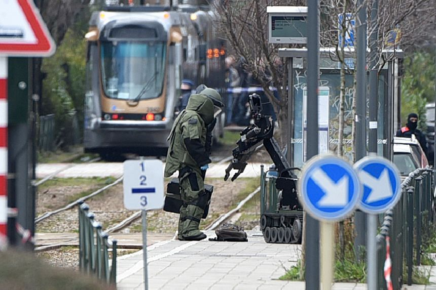 A French police source said the raids in the Brussels suburb of Schaerbeek were related to the arrest of 34-year-old Reda Kriket in Paris on March 24, who was found with heavy weapons and explosives in his apartment.
