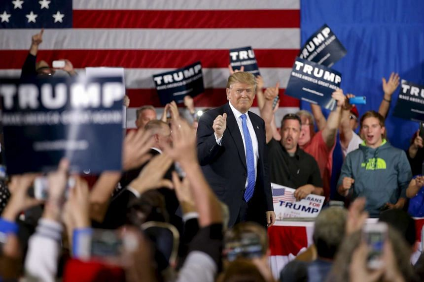 Republican US presidential candidate Donald Trump arrives for a Town Hall in Janesville, Wisconsin, on March 29, 2016.