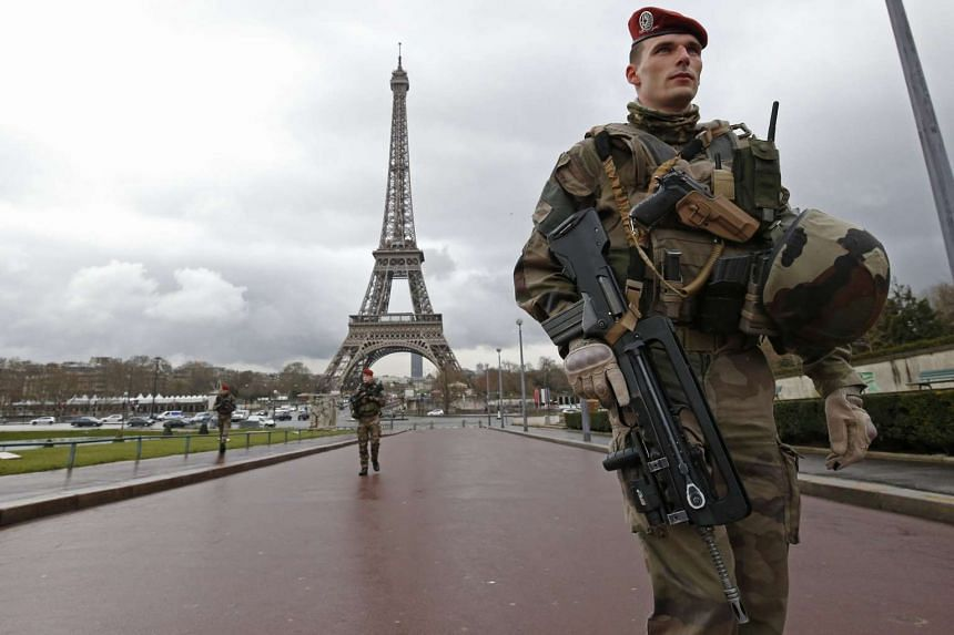 French army paratroopers patrol near the Eiffel Tower in Paris, France.
