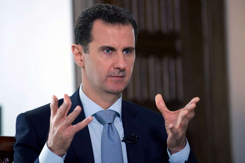 President Bashar al-Assad speaking to a journalist during an interview with Russia's RIA Novosti state news agency in the Syrian capital Damascus.