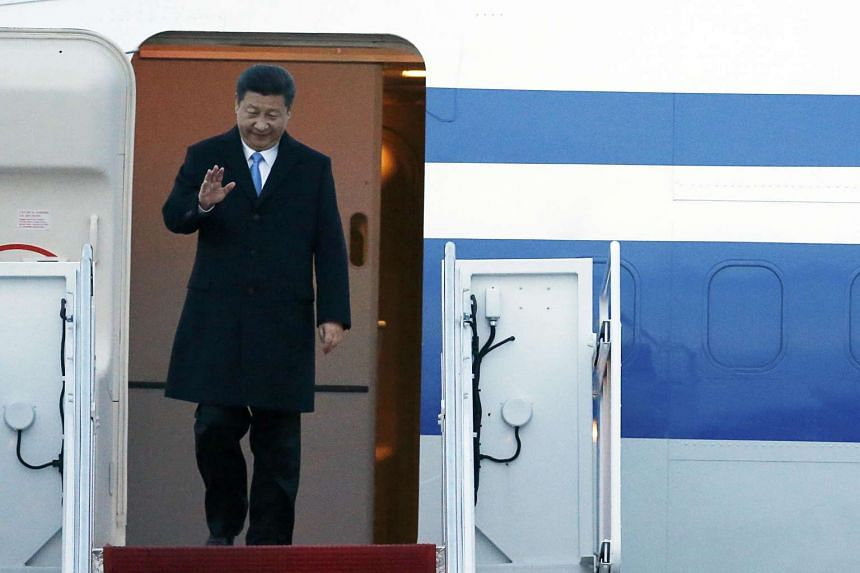 China's President Xi Jinping arrives at Joint Base Andrews, Maryland, on March 30, 2016.