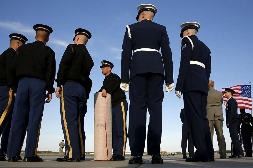Members of a military honor guard prepare to unroll the red carpet to welcome world leaders at the Nuclear Security Summit meetings in Washingtom, on March 30, 2016.