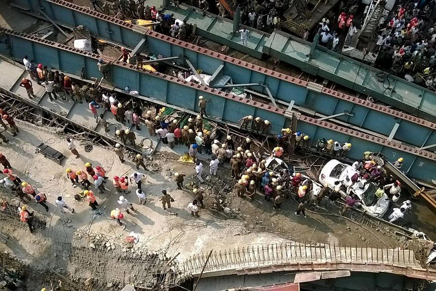 The collapsed flyover in Kolkata that fell on to moving traffic below.