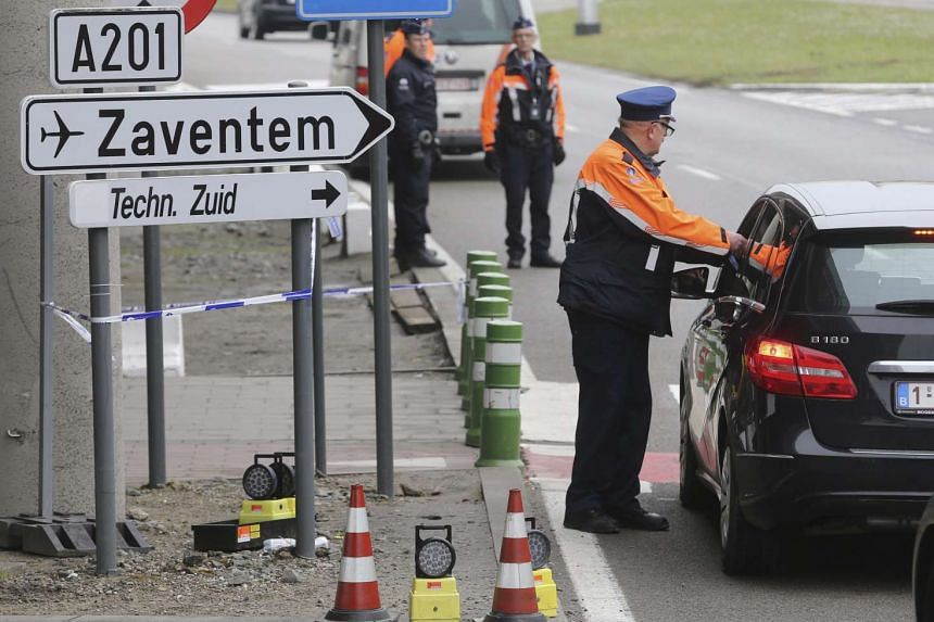 Police forces check vehicles at the entry to Brussels Zaventem airport in Brussels, Belgium, on March 31, 2016.