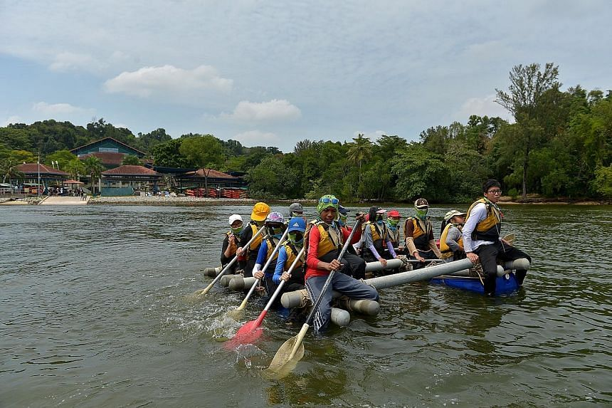 Participants on a water raft they constructed at OBS' Pulau Ubin campus. OBS is looking into different ideas to fully utilise the potential of its campus on Coney Island and its location.