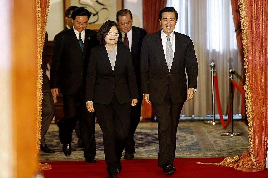 Taiwanese President-elect Tsai Ing-wen with outgoing President Ma Ying-jeou in Taipei yesterday - their first meeting since Ms Tsai and the DPP swept to victory in the Jan 16 elections. Both leaders struck a conciliatory note, with the KMT's Mr Ma sa