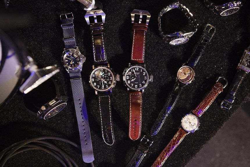 Kiss drummer Eric Singer (above) and some watches from his collection (left).