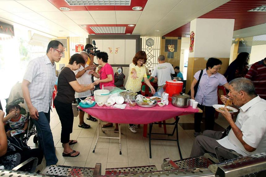 Residents gathering at the seniors' corner of Block 22 Geylang Serai for a monthly breakfast session, on March 31, 2016.