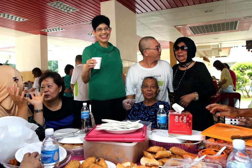 Associate Professor Fatimah Lateef (in green) chatting with residents at the monthly breakfast session, on March 31, 2016.