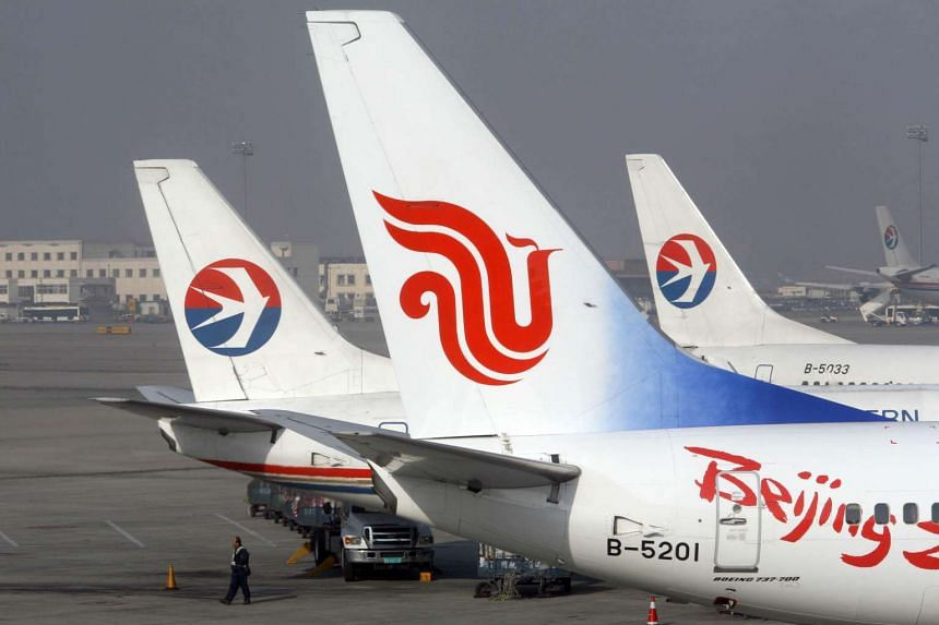 The Air China plane (centre), is seen among China Eastern Airlines planes at Beijing Capital International Airport, China.