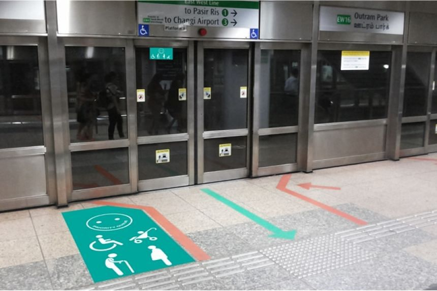 A mock-up of the priority queue system on the East-West Line at Outram Park MRT station.