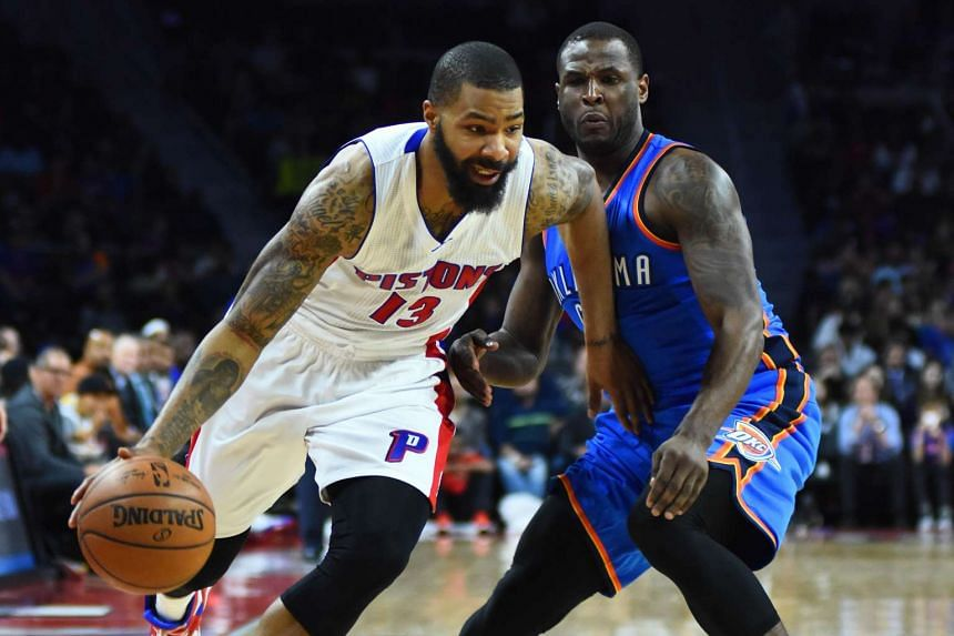 Detroit Pistons forward Marcus Morris (13) dribbles the ball as Oklahoma City Thunder guard Dion Waiters (3) defends.