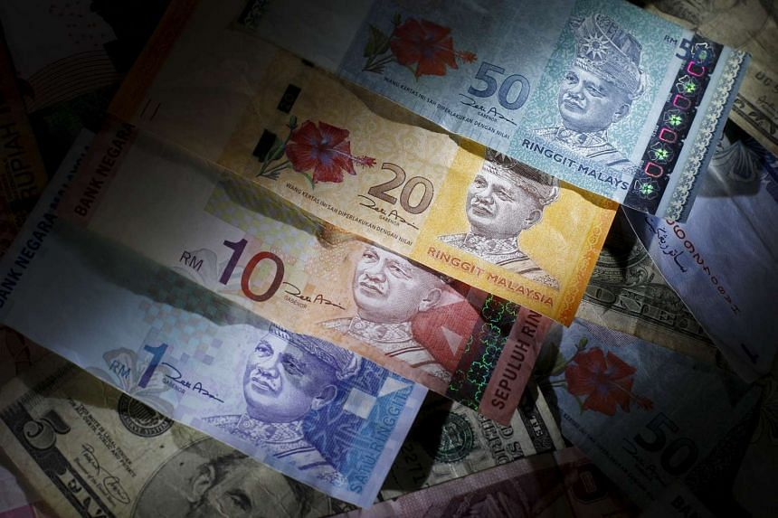 Malaysian ringgit notes are seen among other currency notes in this photograph illustration.
