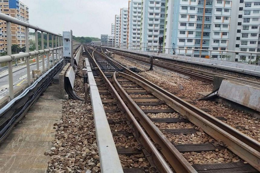 SMRT has to ensure that no trains are driven in automatic mode for sections of the track where workers are on an adjacent track walkway.
