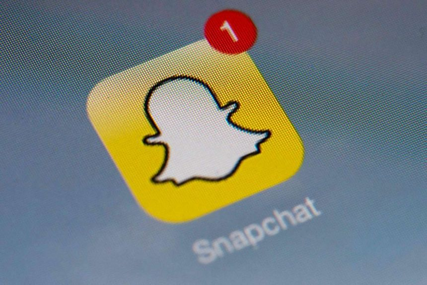 The logo of mobile app Snapchat displayed on a tablet in Paris.