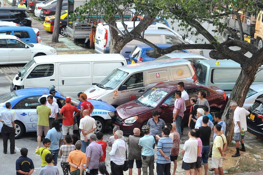 The elderly woman had been collecting cardboard boxes behind a coffee shop at Block 123 in Bedok North Street 2 when the accident occurred. The taxi (above) eventually came to a stop in front of a maroon car and silver van, both of which were damaged