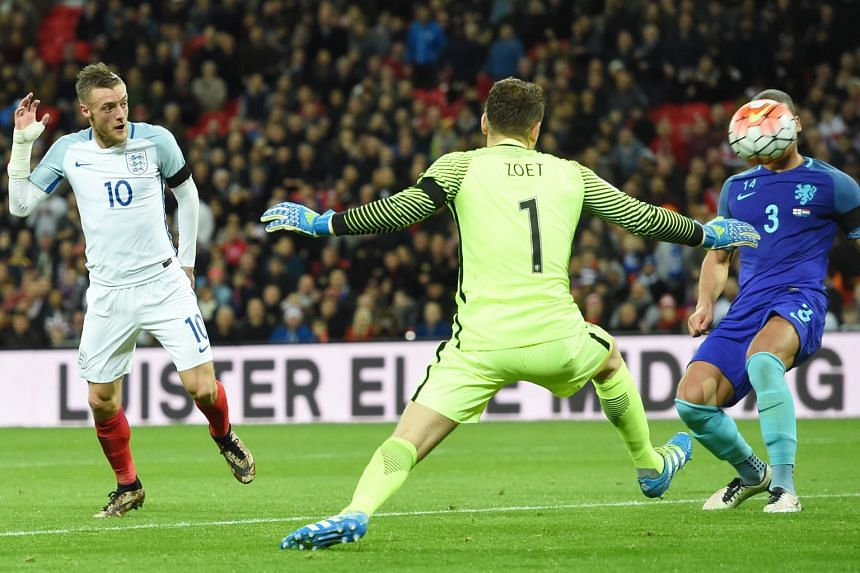 England's Jamie Vardy (left) scoring England's only goal in the 1-2 loss to the Netherlands in the international friendly at Wembley Stadium on Tuesday. It was Vardy's second goal in as many games for England.