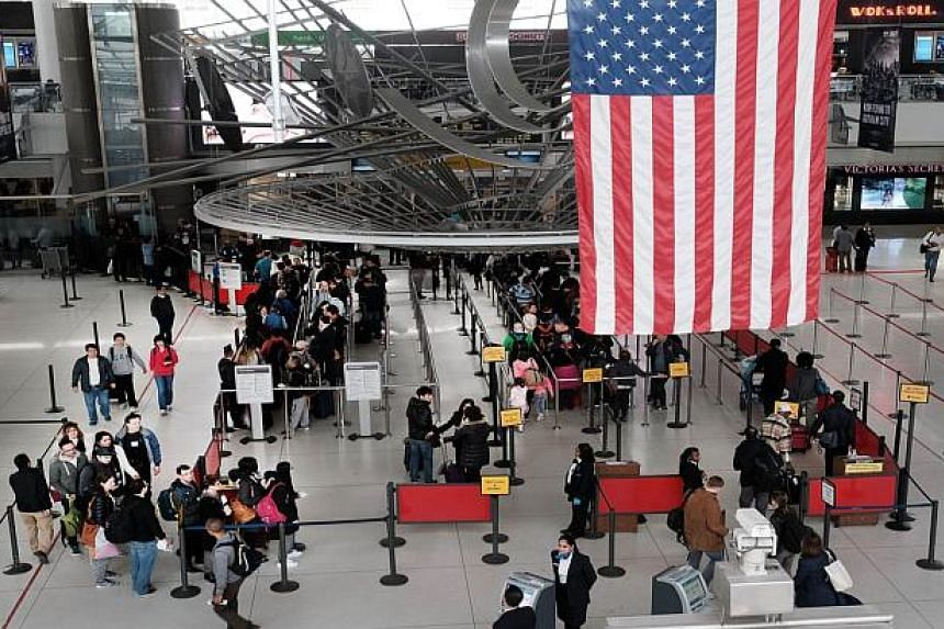 People wait in a security line at John F. Kennedy Airport, New York City, on March 24, 2016.