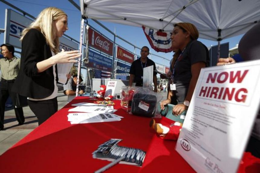 People browse booths at a military veterans' job fair in Carson, California, in this file photo taken on Oct 3, 2014.