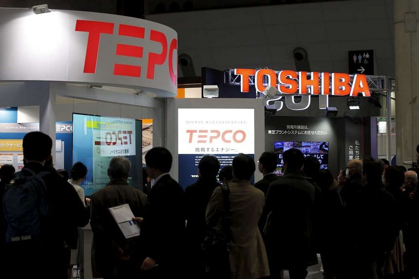 Visitors gather in front of booths of Tokyo Electric Power Co. and Toshiba at the Energy Market Liberalisation Expo in Tokyo, Japan on March 2, 2016.