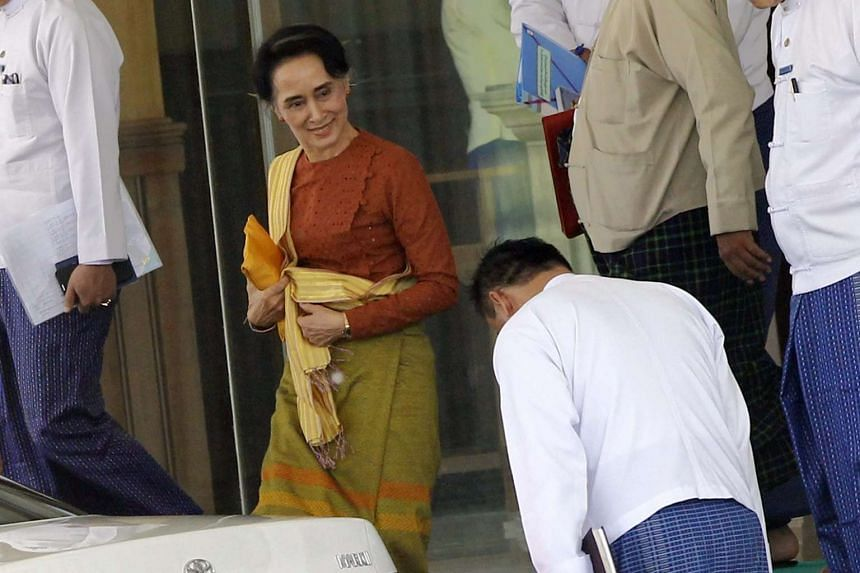 Aung San Suu Kyi (centre) leaves the Ministry of Foreign Affairs in Naypyitaw, Myanmar on April 1, 2016.