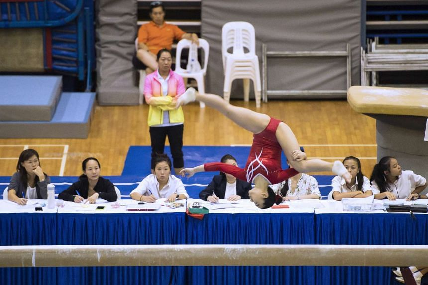 Ms Togawa Mei competes in the balance beam IAF, B Division Girls Secondary (Optional) event at the National Inter-school Artistic Gymnastics Championships.