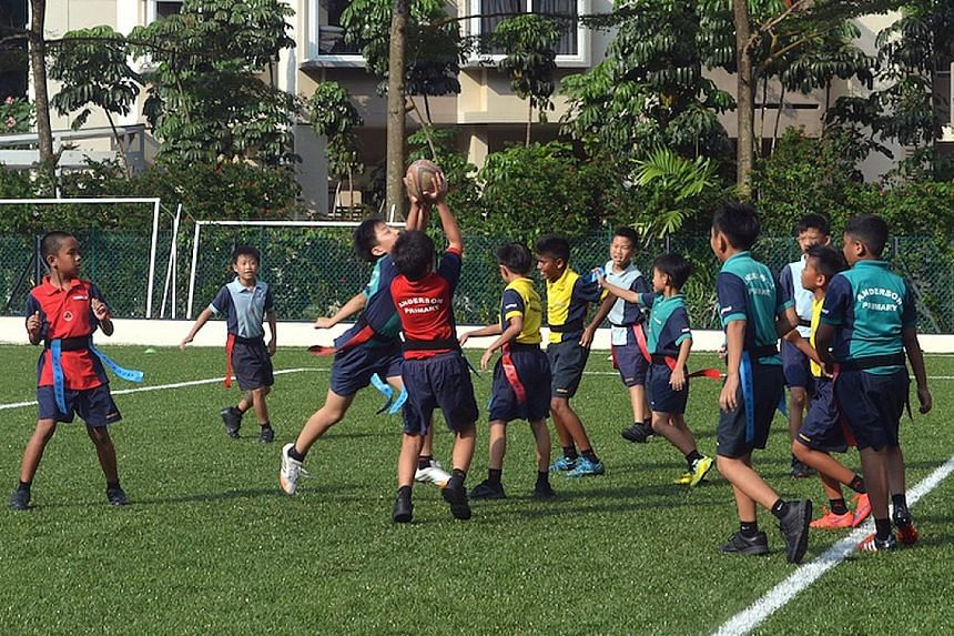 Anderson Primary pupils enjoying a game of Tag 7 yesterday afternoon, as part of the Tag 7s programme conducted by Rugby Singapore. The game is a modified version of rugby, with simulated scrums and line-outs. The programme aims to introduce rugby to
