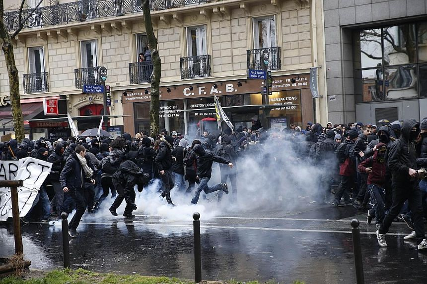 French riot police clashing with protesters demonstrating against labour law reforms yesterday near the Gare de Lyon train station in Paris. The fresh protests over the proposed reforms came just a day after the beleaguered government of President Fr