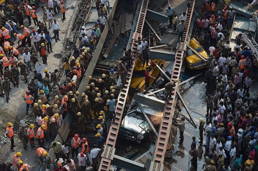 Indian rescue workers and volunteers trying to free people trapped under the wreckage of the collapsed flyover in Kolkata yesterday. The accident is the latest in a series of deadly construction collapses, some of which have put the spotlight on shod