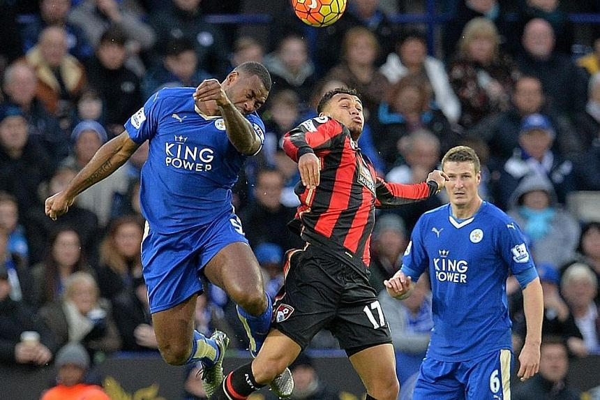Leicester's Wes Morgan (left) and Robert Huth (right) in action against Bournemouth's Joshua King in a Premier League match in January. Alex Ferguson believes that the duo's defensive partnership has been vital in Leicester's success this season.