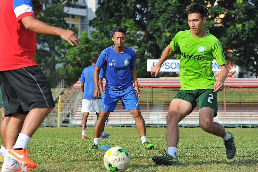 Geylang International head coach Hasrin Jailani (centre) and midfielder Anders Eric Aplin during training at Bedok Stadium on Wednesday, in preparation for the game against Warriors FC today.